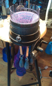 Wool socks are made on this 1908 Gearhart Circular Sock Knitting Machine.