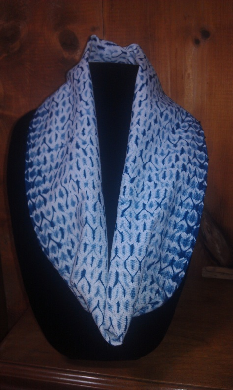 Woven shibori circle scarf, embellished with indigo-color glass beads along the long edges.