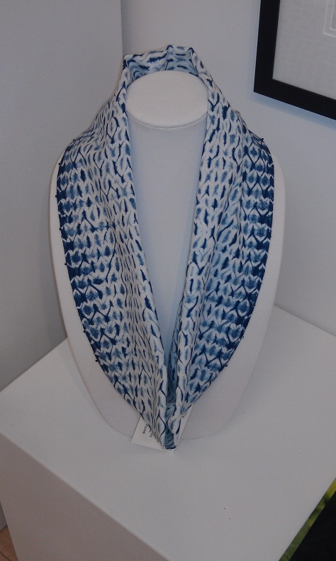 Woven shibori circle scarf, embellished with clear glass beads along the long edges.