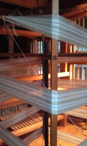 Winding a new warp on a vertical warping mill.