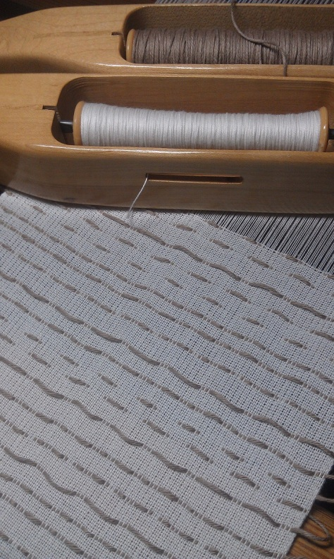 Woven shibori on the loom.