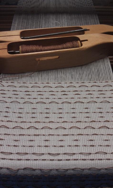 Woven shibori scarf in progress.