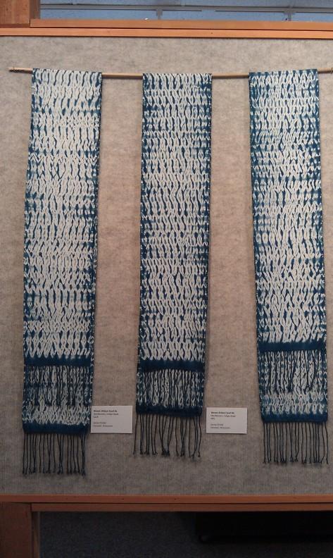 Three woven shiboi scarves.
