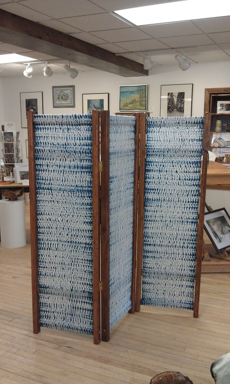 Woven shibori three-panel room divider/screen.