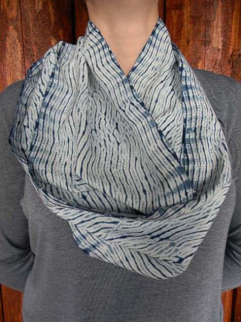 Woven shibori mobius scarf, indigo-dyed.