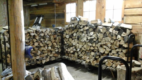 Two double wood racks full, in the garage.